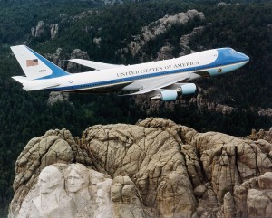 """Air Force One over Mt. Rushmore"" by U.S. Air Force File Photo."