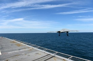 The X-47B leaving the carrier deck for the first time. (U.S. Navy photo by Mass Communication Specialist 2nd Class Tony D. Curtis/Released)